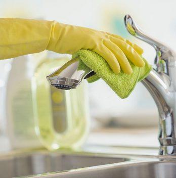 How to clean a pull-down kitchen faucet spray head
