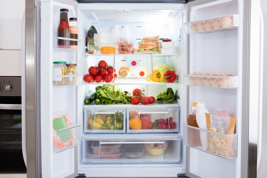 Clear and rearrange food in the fridge